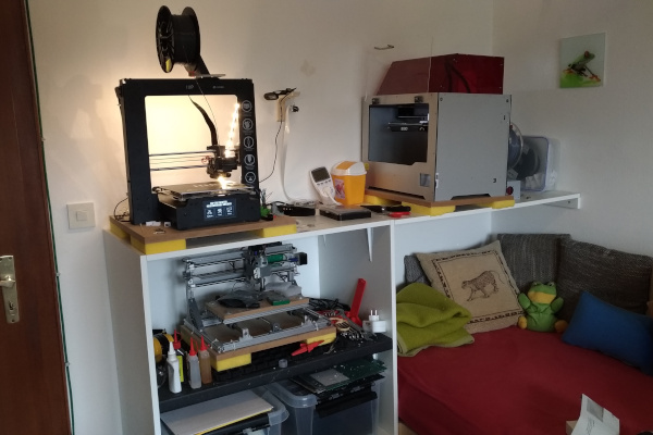 My 'Maker Space' on July 22, 2018 featuring two 3D printers and a CNC mill.